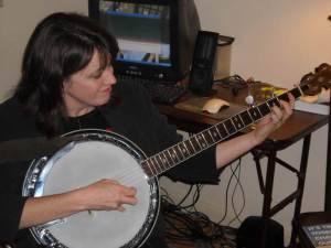 Mrs. Stouffer on the banjo
