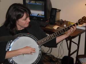 Mrs. Stouffer on the banjo